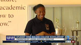 Surprise scholarship awarded to Dunbar junior - Video