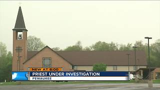Pewaukee priest accused of 'inappropriate contact' with a minor - Video