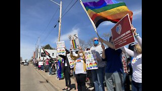 Community members protest homophobic sign