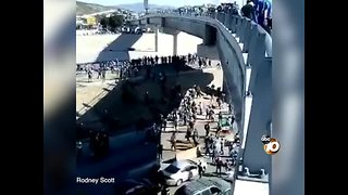 Migrants rush border to demand asylum - Video