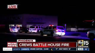 Police, fire crews respond to house fire in Phoenix - Video