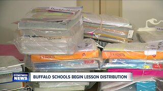 Buffalo school families picking up student lesson plans & meals