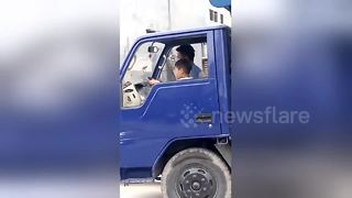 Seven-year-old boy drives truck down busy road