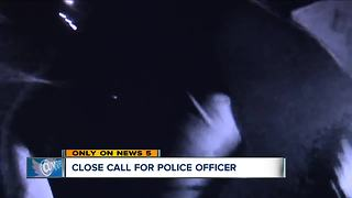 Close call for Massillon police officer during traffic stop - Video