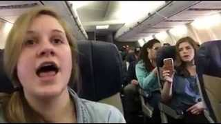 Mona Shores Choir Treats Delayed Passengers to Impromptu Concert - Video