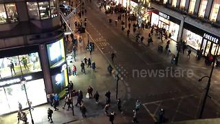 Aerial view captures panic at Oxford Circus - Video