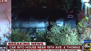 Car collides into home, driver suspected of driving impaired - Video