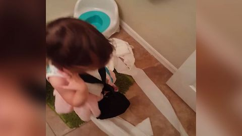 Little Girl Takes Care Of Bathroom Business
