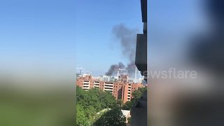Smoke pours out of Arthur Capper Senior Apartments near DC's Navy Yard - Video