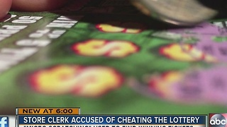 Store clerk accused of cheating the lottery - Video