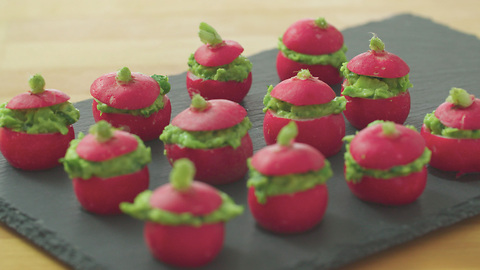 Xanthe Clay's radish canapés filled with pea guacamole