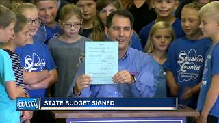 Walker makes statement on education with budget signing - Video