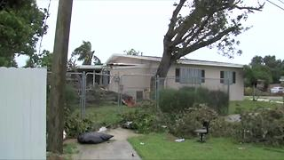 South Miami residents cleaning up storm damage - Video