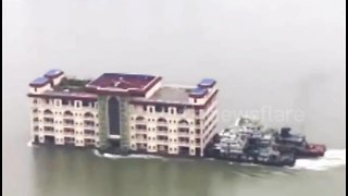 'Floating apartment building' boat moved downriver in China