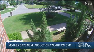 Mother says near abduction caught on cam
