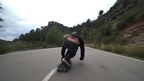 Extreme Downhill Skateboarding At High Speeds