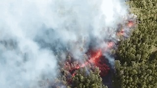 Lava Spews From Fissure Downhill From Kilauea Volcano - Video