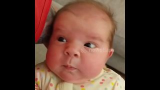 Newborn girl confused by her first sneeze - Video
