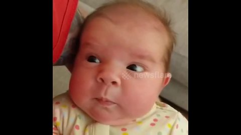 Newborn girl confused by her first sneeze
