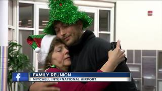 Families reunite for Christmas at Mitchell Airport - Video