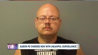 Albion man charged with unlawful surveillance - Video