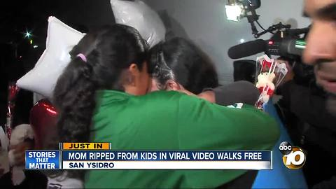 Mom ripped from kids in viral video walks free