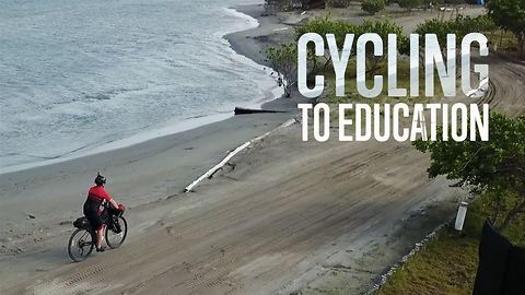 A kid's right to school is in this cyclist's hands