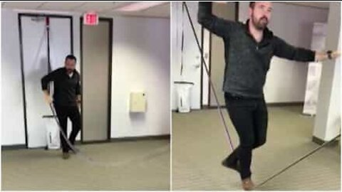 This guy set up a slackline in the middle of the office!