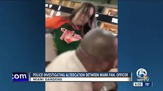 University of Miami football fan charged with assault after slapping officer - Video