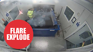 A flare explodes in a waste worker's hands after being left in a recycling bin - Video