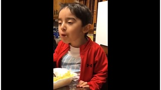 3-year-old is really enjoying his meal - Video