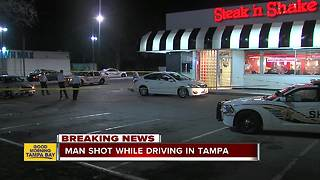 Man shot while driving to Steak 'n Shake in Tampa - Video
