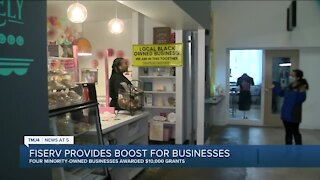 Local minority-owned business owners receive grant from Fiserv