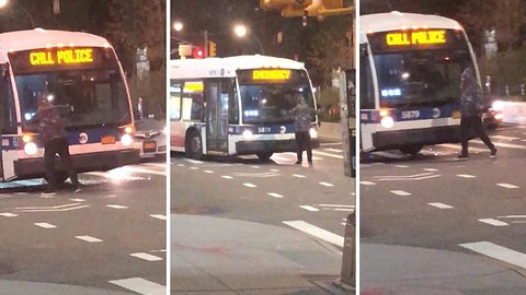 Bizarre moment man stands in front of bus and rips off its wing mirror and windscreen wiper