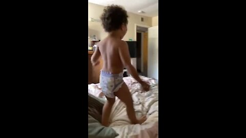 Dad and son have epic WWE wrestling match on the bed