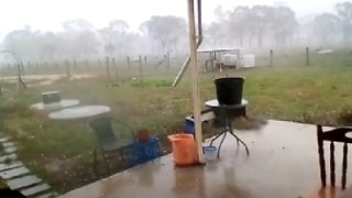 Large Hailstones Pelt Queensland Town as Severe Storm Develops - Video
