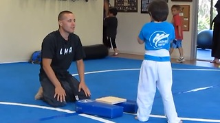Sensei Inspires Young Karate Kid To Break A Wooden Board - Video