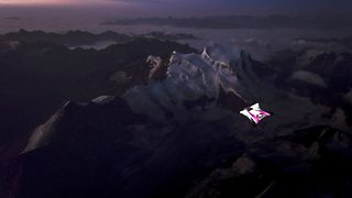 Flying star – Wingsuit jumper lit up at night