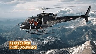 Daredevils Fly Helicopter With Open Doors Over Austrian Alps - Video