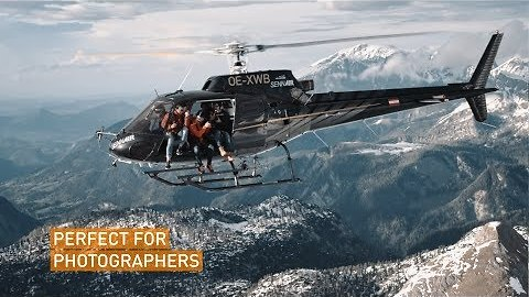 Daredevils Fly Helicopter With Open Doors Over Austrian Alps