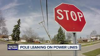 Pole leaning on power lines