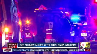 Two children injured after truck crashes into home