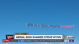 Woman's advocacy group flies banner reading