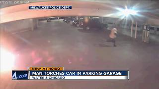 Man torches car in parking garage - Video