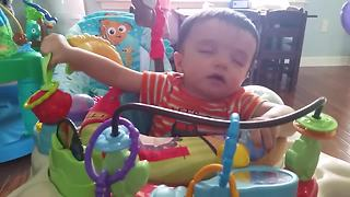 Multitasking Baby Bounces Himself To Sleep
