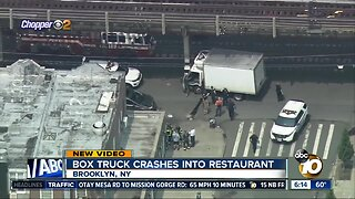 Box truck crashes into restaurant in New York