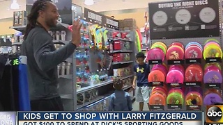 Arizona Cardinals' Larry Fitzgerald gives kids shopping spree - Video