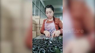 Woman Worker Packing Bearings With Amazing Speed