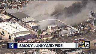 Junkyard goes up in flames, firefighter suffer overheating - Video