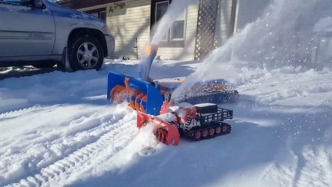 Creative homeowner 3D prints two of his own snow blower to clear garden